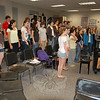 Newtown High School's Chamber Choir, under the guidance of NHS teacher John Harned, practiced on Monday, April 5, for their then-upcoming performance on April 8 at the 65th Annual Connecticut Music Educator's Association Conference.  (Hallabeck photo)