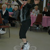 Rolled-up jeans, hair bows for women, and high spirits for all was the order of the day at Newtown Senior Center on March 24, as At The Hop band got seniors rockin' and rollin' to tunes of the 50s and 60s. Agnes Jensen kicked up her heels during the special event.  (Crevier photo)