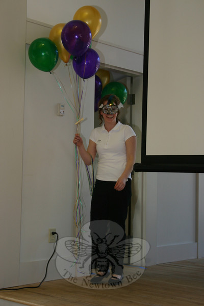 Campers, including Leigh Gerety, seen here, began the morning's entertainment segment by entering the hall wearing Mardi Gras masks and carrying balloons.  (Hicks photo)
