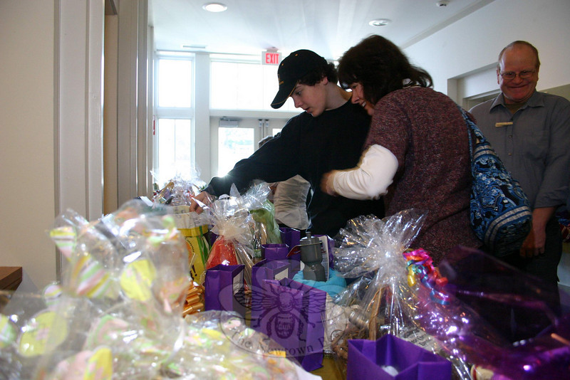 Workcampers arranged for 56 theme baskets, which were raffled during their fundraising breakfast on March 27.  (Hicks photo)