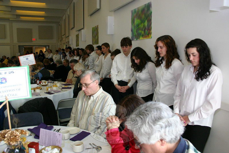 Workcamers and their guests paused for the morning prayer during the NEWS fundraising breakfast, held this year for the first time at Newtown Congregational Church.  (Hicks photo)