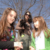 Cailee Harvey, left, and Yael Bialik stand with Grace Harvey and their little dog Cooper on Sunday, waiting for the morning's walk to begin.  (Bobowick photo)