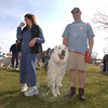 Scott Bialik and his Great Pyrenese find some room to stretch at the crowded Fairfield Hills grounds where dogs and pet owners gathered for the 2 Dogs 2,000 Mile walk. Beside him is Long Island resident Joni Spielberg, who traveled to Newtown for the weekend's walk.  (Bobowick photo)