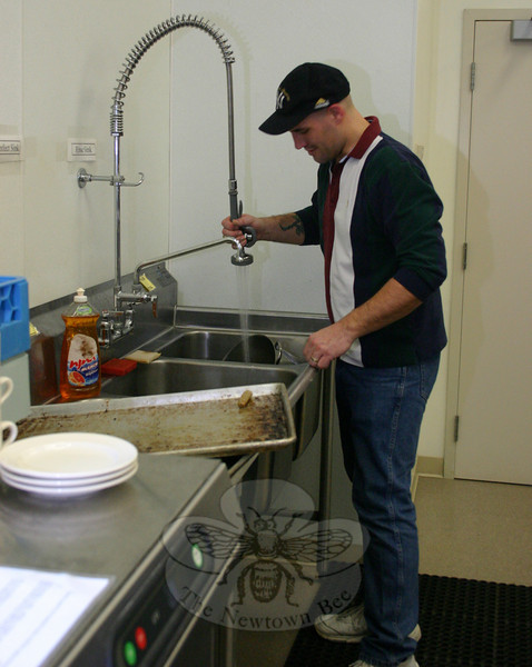 Members of the NCC Men's Club and St Rose Knights of Columbus prepared the food for the NEWS workcamp breakfast on March 28. St Rose member Markus Balis also took care of some of the morning's dishwashing duties.  (Hicks photo)