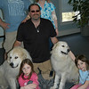 Luke Robinson, center kneeling, poses with his dogs Murphy and Hudson, and Scott and Jodi Bialki, standing, and their daughters Avi, left, and Yael. The Bialik family hosted Mr Robinson and his dogs in late February, and were instrumental in putting together the walk at Fairfield Hills and a meet and greet at the library, Sunday, March 21.  (Crevier photo)