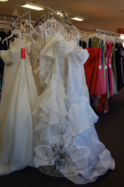 Julie Allen Bridal is featuring a trunk show of wedding gowns by Watters during its 40th anniversary celebration, an example of those gowns shown in this photo. Knowing the merchandise, and knowing what brides expect from a bridal salon, are just two of the reasons behind the forty years of success, says Melanie Mattegat, who owns the shop with her husband, Jay.  (Crevier photo)