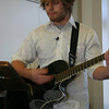 """Workcamper Jeff Keating performed a few songs during the entertainment portion of the NEWS Workcamp Breakfast, including """"House of the Rising Sun.""""  (Hicks photo)"""