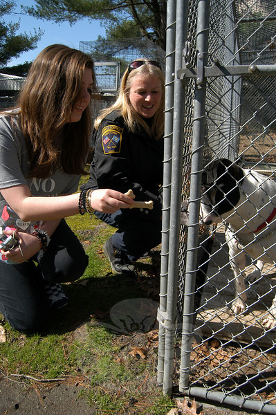 NHS Vegetarian and Animal Concerns Club founder Alissa Silber, left, feeds Theo a treat while Animal Control Officer Carolee Mason watches.  (Hallabeck photo)