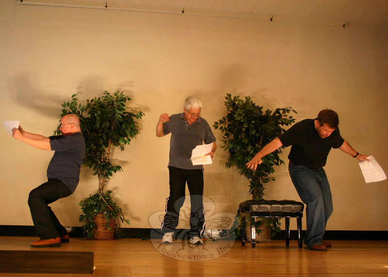 Play With Your Food's season finale at Edmond Town Hall wrapped with a performance of Judgment Call, in which three Major League Baseball umpires — from left, Richard Leonard, Don Striano, and Michael Habetz — prepare for a new season.  (Hicks photo)