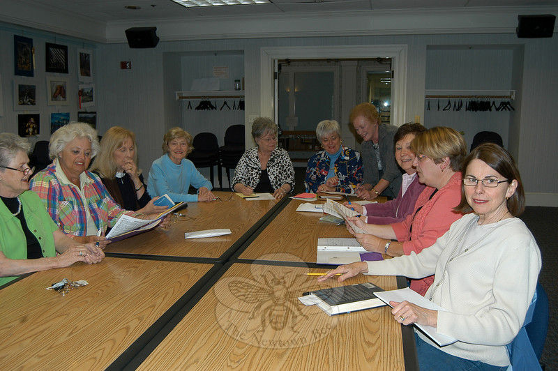 From left at head of table, Marilyn Alexander and Marie Sturdevant go over details of the upcoming Woman's Club of Newtown, GFWC, Inc fashion show, while Yvonne Kopins looks on. Also in attendance at the Tuesday, April 13, planning meeting at C.H. Booth Library were Woman's Club members Mary Ruffles, JoAnn Bruno, Rosemary Rau, Charleen Swan-son, Marg Studley, Colleen Honan, and Debbie Stakel.  (Crevier photo)