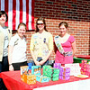 Girl Scout troops of all levels been seen around town lately, selling Girl Scout Cookies from tables set up on sidewalks in front of grocery stores, diners and delis, among other locations. From left is Claire Olson, Laura Hunter, Natalie Dieckman, and Melissa Janco, who are members of Senior Troop 50602 and were stationed outside Drug Center Pharmacy and Newtown Hardware for a few hours during the beautiful afternoon hours of Saturday, March 13.  (Hicks photo)