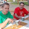Event organizer Michael Porco Jr, right, and Porco's Karate Acadey instructor Christopher Perry eat donuts at Andrea's Pastry Shop during the third Annual Donut Dash.  (Hallabeck photo)