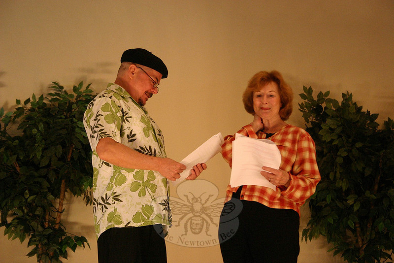 In The Betrothal, horticulturists Kermit Wasserman (Richard Leonard) and J.H. Joslyn (Joan Grant) have an argumentative yet captivating encounter after showing their prize irises.  (Hicks photo)