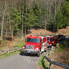Two engines and the brush truck from Sandy Hook Volunteer Fire & Rescue Co. filled a driveway on Miya Lane on Sunday, when the company responded to a brush fire in the woods between Miya Lane and Narragansett Trail.  (Hicks photo)