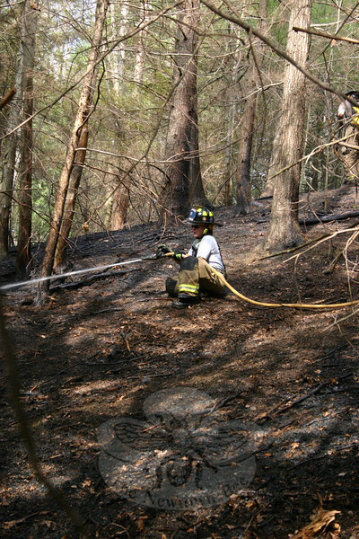 Sandy Hook Firefighter and EMS Captain Karin Halstead handled the hose line on Sunday afternoon when Sandy Hook Volunteer Fire & Rescue responded to a brush fire in the woods between Miya Lane and Narragansett Trail.  (Hicks photo)