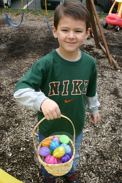 Philip Cappelli proudly showed off the basket he filled with colorful eggs following his participation in an Easter egg hunt at Newtown Congregational Church on Palm Sunday.  (Hicks photo)