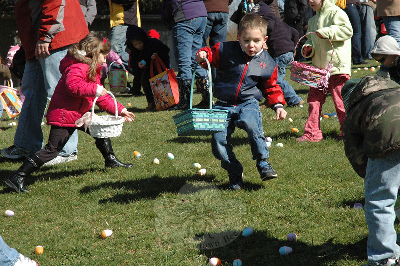 Scrambling children were among the many youths who attended the town's annual Spring Egg Hunt held at Dickinson Park. Two egg hunts were conducted, one for younger children, and a second for an older age group.  (Gorosko photo)