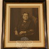 "Mary Elizabeth Hawley is one of the most celebrated of Newtown's historic figures. Joyce DeWolfe says she nearly fell off her chair when she realized she was related — ""albeit distantly,"" she admits, ""but still, it's just so funny!"" — to Newtown's beloved benefactress. This portrait is part of C.H. Booth Library's permanent collection.  (Hicks photo)"
