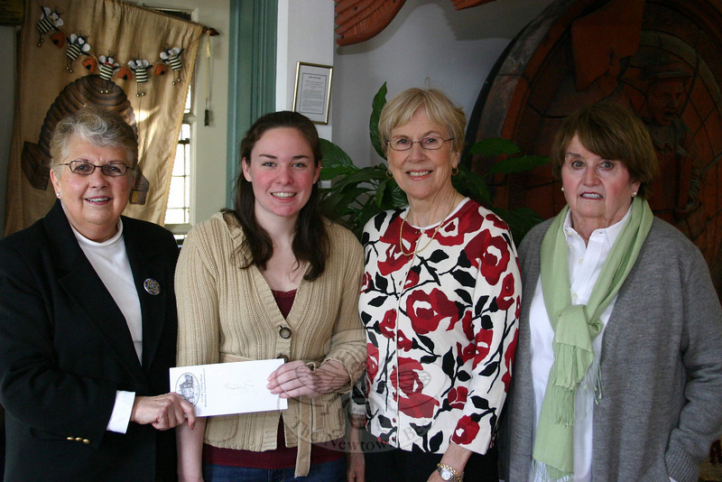 VNA Scholarship Committee Chairman Sally Schwerdtle, left, recently presented the Janice B. VanSyckle Scholarship to Jillian D'Eramo, second from left. Mrs Schwerdtle was joined by fellow Newtown VNA members Margareta Kotch, second from right, and Maureen McLachlan for the presentation. Jillian is a student at the University of Scranton in Scranton, Penn. She is studying for a bachelor of science degree in nursing (BSN).  (Hicks photo)