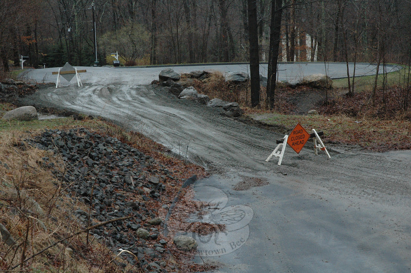 The town linked the turnaround circle of Turkey Hill Road, foreground, to the turnaround circle of Little Brook Lane with a temporary road on Tuesday to provide an emergency accessway into the Turkey Hill Road area neighborhood when it appeared that high water in the Pootatuck River might flood a Turkey Hill Road bridge above the river.  (Gorosko photo)