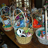 Donations piled high as Women Involved in Newtown members worked to assemble 165 Easter baskets on Thursday, March 24. The baskets will be going to Interfaith AIDS Ministry of Danbury, Healing Hearts in Danbury, and Social Services in Newtown. For the baskets, stuffed animals were collected and donated, with St Rose of Lima and Reed Intermediate School donating the most, and WIN donated the candy.  (Hallabeck photo)