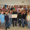NMS Student Council treasurer Noelle Benson, third from left, presents Newtown dog pound kennel attendant Matt Schaub with a check for $350 on Monday, March 29, while members of the student council gather around. Animal Control Officer Carolee Mason (third from right) and dog pound volunteer Amy Sullivan (second from right) were on hand for the presentation as well. The check represents money raised through efforts of the student council to support the dog pound.  (Crevier photo)