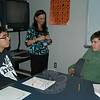 Sheila Russo of Newtown Youth & Family Services, center, oversaw Newtown High School students Terence Lee, right, and Christopher Rekofsky role playing an interview scenario at Newtown High School on Monday, March 29, for the Interview Skills Workshop For Youth.  (Hallabeck photo)