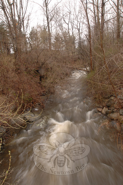 Water rushing through a stream near Commerce Road, Tuesday afternoon.  (Bobowick photo)