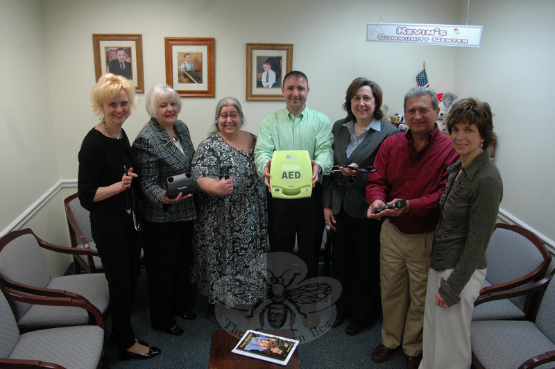 Representatives of Kevin's Community Center and The Newtown Fund met recently to check out nearly $4,000 worth of new clinic equipment that was obtained as a result of donations made through the fund. Pictured from left are KCC Clinical Director Linda Pinkney, LPN, Sharon Maynard, Phyllis Zimmer, Rev Jim Solomon, Ann Ragusa, Rick Mazzariello and Dr Della Schmid.  (Voket photo)