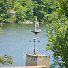 A homeowner's predilection can be guessed at by the weathervane that tops the house. It is not surprising to find this sailboat weathervane catching the winds off of Taunton Lake. Bee Photo, Nancy K. Crevier