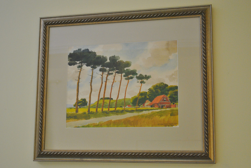 "The restoration of this watercolor, ""Roman Pines"" by late local artist Harrie Wood, as well as several other pieces of artwork, was made possible through the Friends of the C.H. Booth Library ""Vision Project"" this winter, in which library staff was invited to apply for funding for projects not possible through regular funding, up to $10,000, total.  (Crevier photo)"