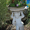 Purchased for a song at an estate sale, the worn façade of this cherub is part of the charm, dressed up with a tub of flowers, says Rita Frost.  (Crevier photo)