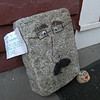 "Someone else has been sauntering around town, and has left some artistically enhanced stone faces on the doorstep of The Bee. These stony visages were accompanied by a mysterious note: ""If you think I'm alone, you're wrong. Look at all the major landscapes in Newtown and you'll find my friends. : ) LMK 2011."""