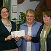Chelsea Fowler of Newtown, who is about the enter her junior year at Western Connecticut State University, was presented with a scholarship check by the Newtown Visiting Nurse Association on June 22. Chelsea, left, accepted the scholarship check from Newtown Visiting Nurse Association Scholarship Committee Chair Sally Schwerdtle, center, and member Maureen McLaughlin.  (Hicks photo)