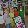 Dylan Greenlaw, 4, Ella Hall, 5, Giselle Alvarez, 4, and Emily Hechler, 5, four of the 3- to 6-year-old artists of The Children's Adventure Center who wielded brushes, crayons, paints, pencils, and numerous other craft items throughout the year to create multimedia works featured in the Third Annual Children's Adventure Center Art Show, held Wednesday, June 22, to Wednesday, June 29. The annual event allows the children to showcase the art they have created, said instructor Kathi Surawsar, and provides a venue for family members to see the work.  (Crevier photo)