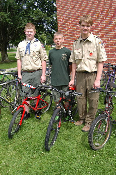 Newtown High School Class of 2011 graduate Zach Baudisch eagerly helped residents who stopped by Newtown Middle School's parking lot on Sunday, June 19, to add bicycles to his Eagle Scout Project collection. Zach, a member of Newtown Boy Scout Troop 370, collected bikes over the course of ten days. By the last collection day, Zach said he had surpassed his goal of collecting 60 bikes to be shipped to underdeveloped countries in Africa. Zach, right, was assisted by Michael Cook, center, and Jack Beal, left, for part of the day on Sunday. By the end of the collection, Zach had collected so many bikes the collection agency needed to return for another pickup. For additional information about the project contact Zach at 203-270-6910 or at ZkBaudisch@yahoo.com. 	      (Hallabeck photo)