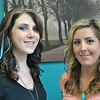 Stylists Mary Straniti, left, and Ali Carrier of Salon Michele in Newtown model feather hair extensions, a wildly popular summer trend popularized by entertainment stars in recent months. Fly fishermen and animal concerns groups have been less enthralled by the fad, which uses natural feathers from specially bred roosters. 	(Crevier photo)