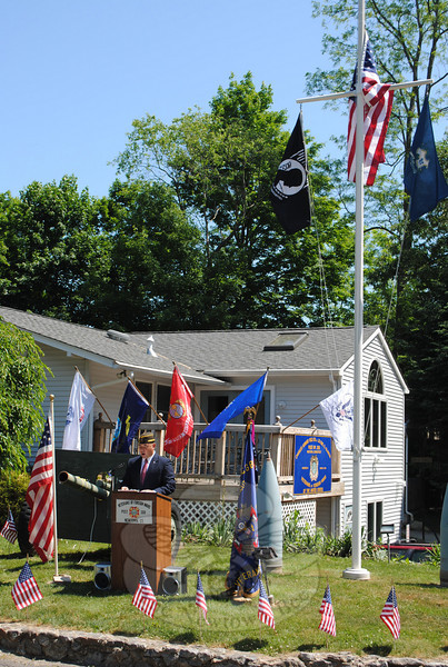 Rich Monckton, Connecticut Army National Guard Alpha Co., 1-102 (at the podium) spoke of the importance of teaching the true meaning of Memorial Day to younger generations at the VFW Memorial Day ceremony on Monday, May 31.  (Crevier photo)