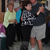 Cy Dennerlein and Tina VonTanhausen dance cheek-to-cheek to music performed by Bob Giannotti, while Theresa Alberico looks on, during a lunchtime musical program. The special event, at Newtown Senior Center on May 18, was sponsored by HealthNet.  (Crevier photo)