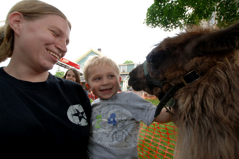Jack Morris, reaching his hand toward Maxwell the llama, shares a laugh with his mother Jodi during the 10th Annual Great Pootatuck Duck Race.  (Bobowick photo)