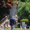 Senior Vice Commander of VFW Post 308 Bill Farley lays a wreath at the memorial headstone outside of the Tinkerfield Road VFW hall. The wreath was to commemorate all those who gave their in service to the United States.  (Crevier photo)
