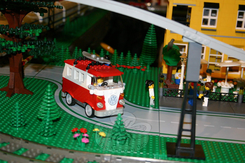 """The Danbury Railway Museum exhibition """"The Connecticut and Vermont LEGO® Railway,"""" an operating model train layout made entirely of Legos, has been extended to June 27. Among the whimsical items within the massive project is this Volkswagen van. The gray line seen slicing through the upper corner of this photo is part of an elevated track, one of at least a half dozen tracks that criss-cross within the display.  (Hicks photo)"""