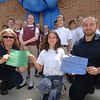 St Rose School student Larissa Spies presented checks to Animal Control Officer Carolee Mason, left, and Assistant Animal Control Officer Matthew Schaub on behalf of her school's Kids For Canines effort to raise funds for both the Canine Advocates of Newtown (CAN) and the dog pound. Checks are for $250 for the pound and $400 for CAN. Gathered behind Larissa are Student Council members who largely helped with the fundraising, and council advisor Beth Salaris.  (Bobowick photo)