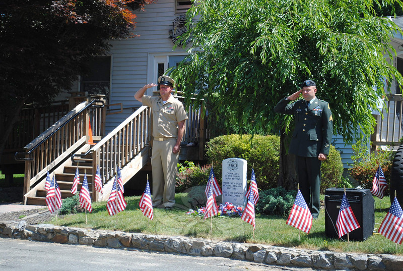 A small but solemn group of residents joined veterans to pay homage to soldiers past and present at a brief Memorial Day ceremony on Monday morning, May 31, at VFW Post 308.  (Crevier photo)