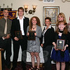 """Newtown Lions Club presented four special awards during its meeting on Wednesday, May 12, at the Stony Hill Inn. The first was its Leo of the Year Award, which goes to a Newtown High School student. Suzanne Hurley, the NHS Leo Club advisor, second from right, said the choice of NHS senior Samantha DeFelippe, standing in front of Ms Hurley, """"wasn't a diffi-cult choice … she's very positive and an instrumental member of the club."""" The William F. Honan Award, which recognizes a male and female high school junior and is based on selection by high school faculty, was awarded to Megan Preis, fourth from left, and Josh Engler, third from left. Megan was nominated by NHS guidance counselor Deidre Croche, who is standing to her right; Josh was nominated by guidance counselor Brett Nichols, who is standing to his left. In addition, Ms Hurley was presented with a Service Award for her dedicated service as the Leo Club Advisor. With the group is Lions Club President Walt Schweikert, left, and Lions Club-Leo Club Liaison Jon Christensen, right.  (Hicks photo)"""