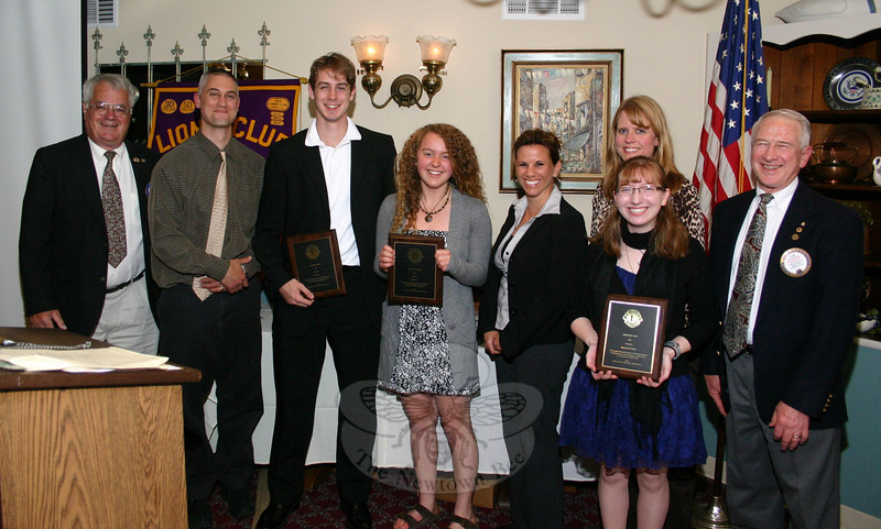 "Newtown Lions Club presented four special awards during its meeting on Wednesday, May 12, at the Stony Hill Inn. The first was its Leo of the Year Award, which goes to a Newtown High School student. Suzanne Hurley, the NHS Leo Club advisor, second from right, said the choice of NHS senior Samantha DeFelippe, standing in front of Ms Hurley, ""wasn't a diffi-cult choice … she's very positive and an instrumental member of the club."" The William F. Honan Award, which recognizes a male and female high school junior and is based on selection by high school faculty, was awarded to Megan Preis, fourth from left, and Josh Engler, third from left. Megan was nominated by NHS guidance counselor Deidre Croche, who is standing to her right; Josh was nominated by guidance counselor Brett Nichols, who is standing to his left. In addition, Ms Hurley was presented with a Service Award for her dedicated service as the Leo Club Advisor. With the group is Lions Club President Walt Schweikert, left, and Lions Club-Leo Club Liaison Jon Christensen, right.  (Hicks photo)"