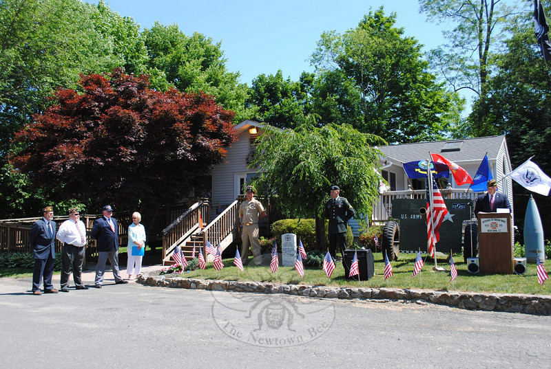 Rich Monckton, Connecticut Army National Guard Alpha Co., 1-102 (at the podium), spoke of the importance of teaching the true meaning of Memorial Day to younger generations at the VFW Memorial Day ceremony on Monday, May 31.  (Crevier photo)