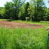 Jim Shortt looks over the first plot of land that has been plowed at the new Cherry Street location. The property acquisition means that Shortt's Farm and Garden will be able to quadruple the amount of organic produce that they can grow, beginning in 2011.  (Crevier photo)