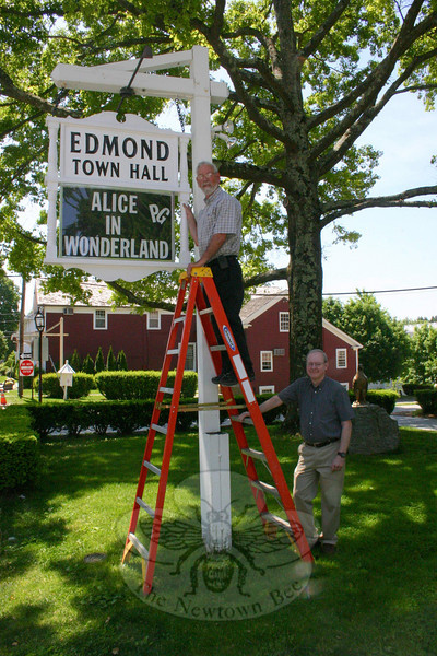 Edmond Town Hall building superintendent Clark Kathan, on the ladder, recently rebuilt the marquee sign for the town hall's theater. With him, on the ground, is Tom Mahoney, the town hall's manager.  (Hicks photo)