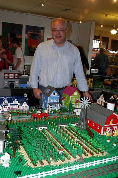 """Bill Probert stands within """"The Connecticut and Vermont Lego Railway,"""" an operating model train layout made entirely of Legos on view at Danbury Railway Museum until June 27. Mr Probert worked with  Elroy Davis and Steve Doerner to create the train layour. All three are members of the New England Lego Users Group (NELUG).  (Hicks photo)"""
